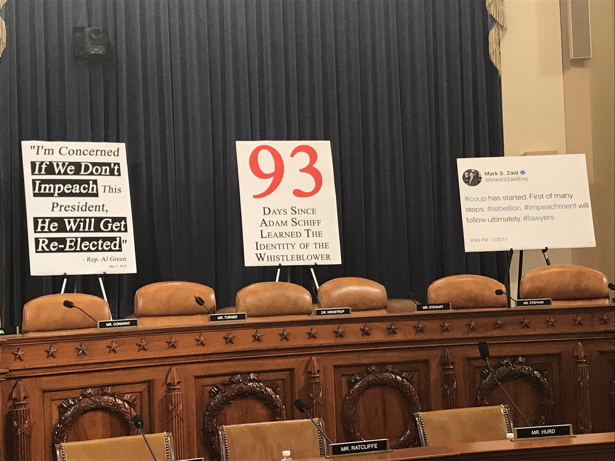 A bunch of obviously partisan posters on tripods, like one that says Adam Schiff has known the identity of the whistleblower for 93 days.