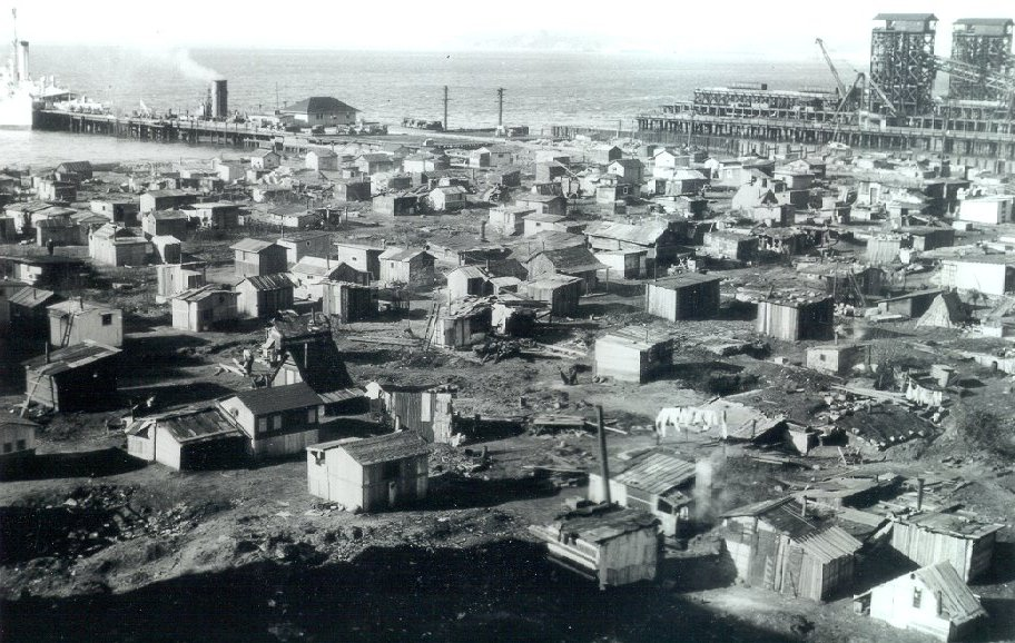 Hooverville with hundreds of temporary shacks made from plywood, cardboard, and aluminum siding