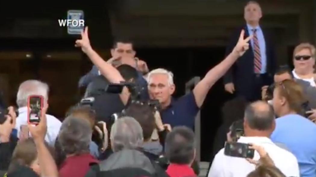 Stone adopts Nixon victory pose