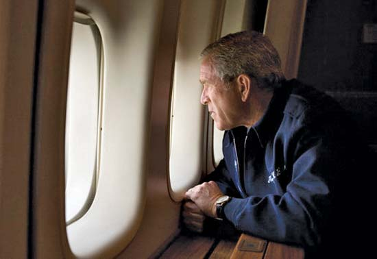 Bush the son looks out the window of Air Force One at the devastation wrought by Hurricane Katrina