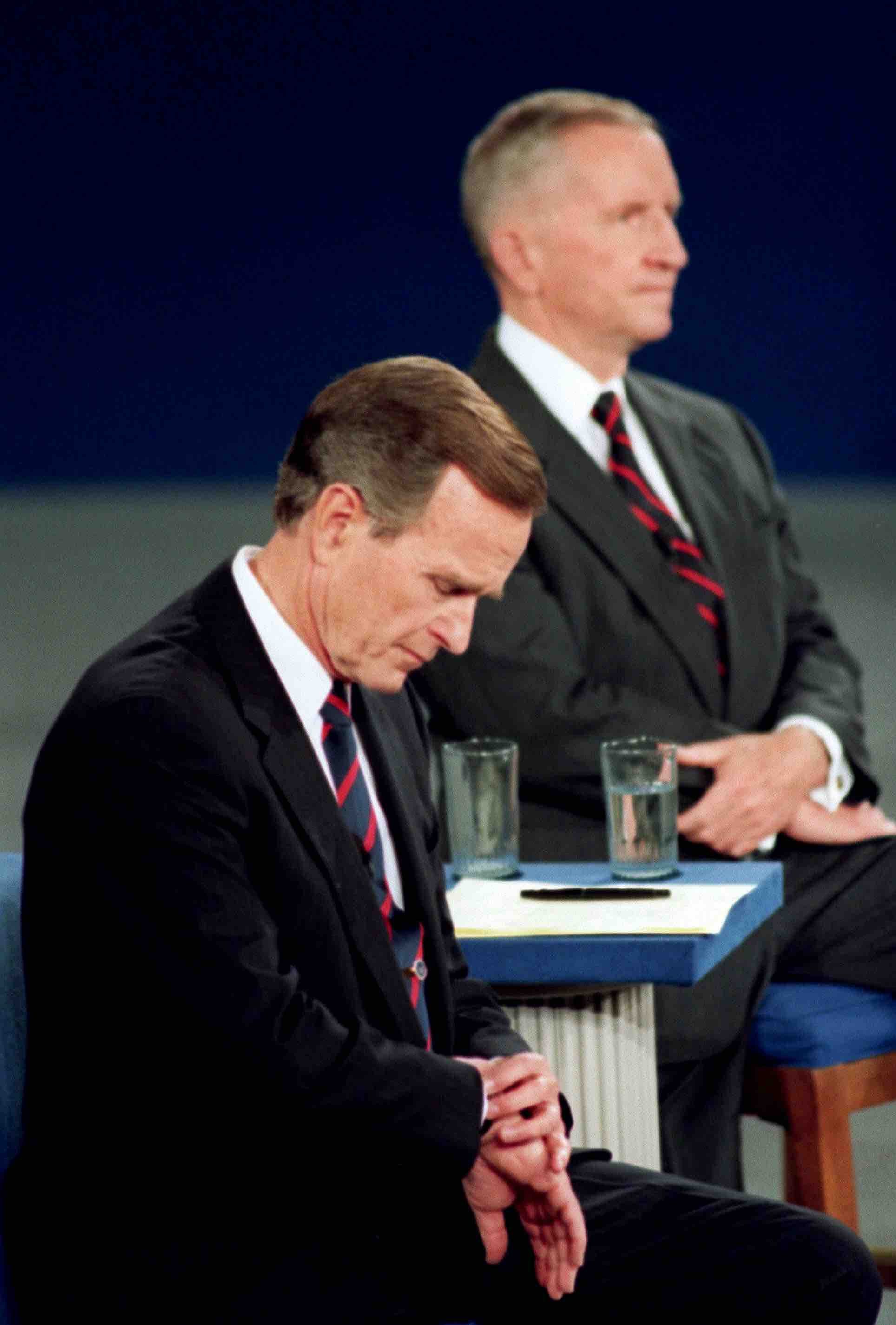 Bush the father glances at his wristwatch during the 1992 presidential debates