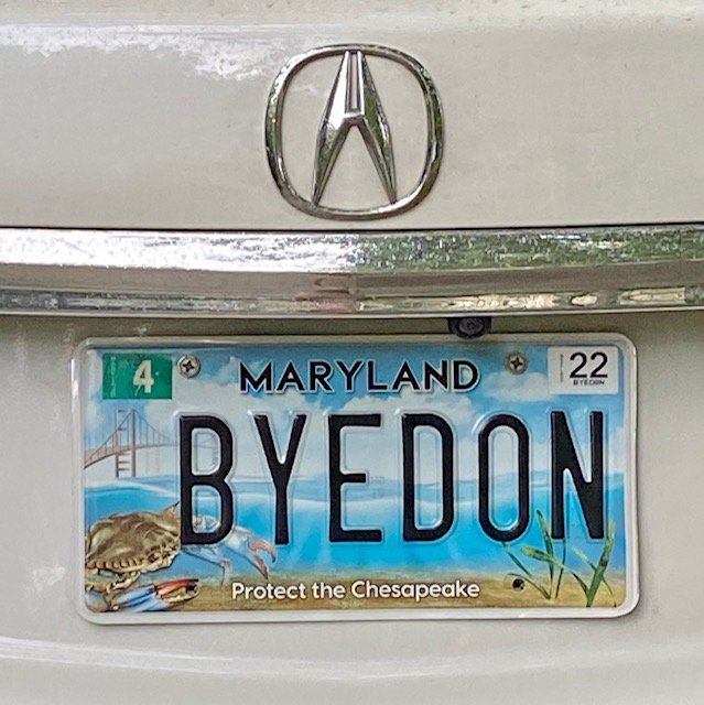 A Maryland license plate reads 'BYEDON'