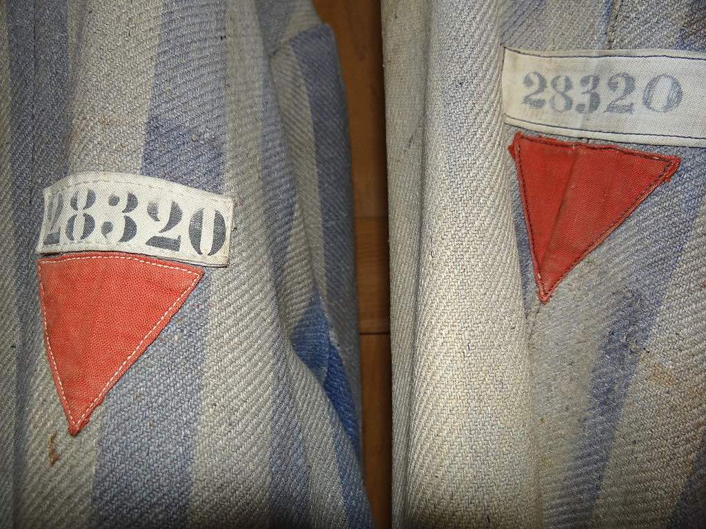 The sleeves of the shirt have a prisoner number with a red triangle underneath