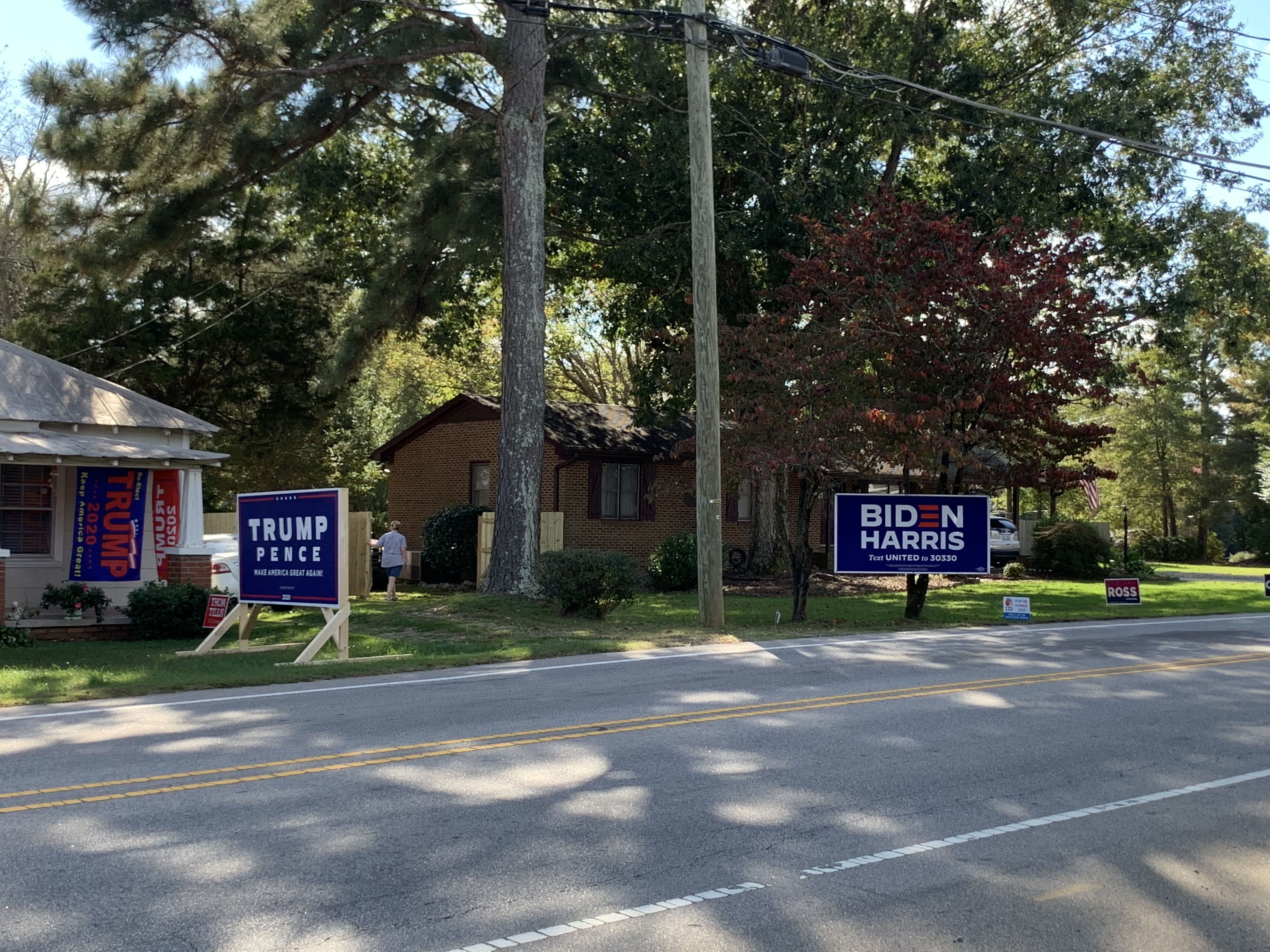 One house has a giant Trump/Pence sign and the other has a giant Biden/Harris sign