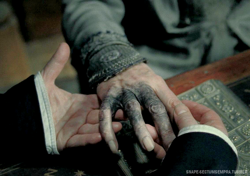 The Harry Potter character's hand is black and withered