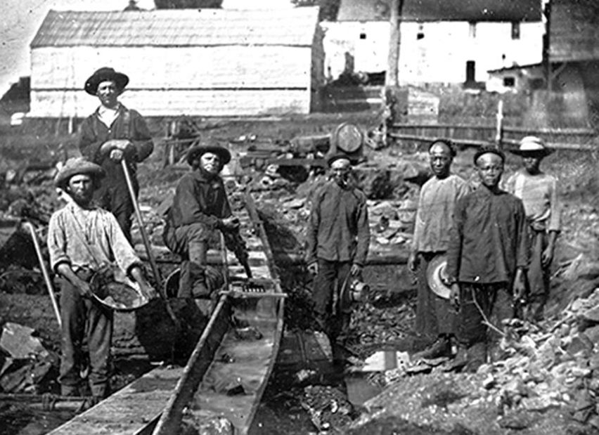 Three white and four Chinese miners, in filthy, torn clothes, and with sunburns so bad they surely got skin cancer