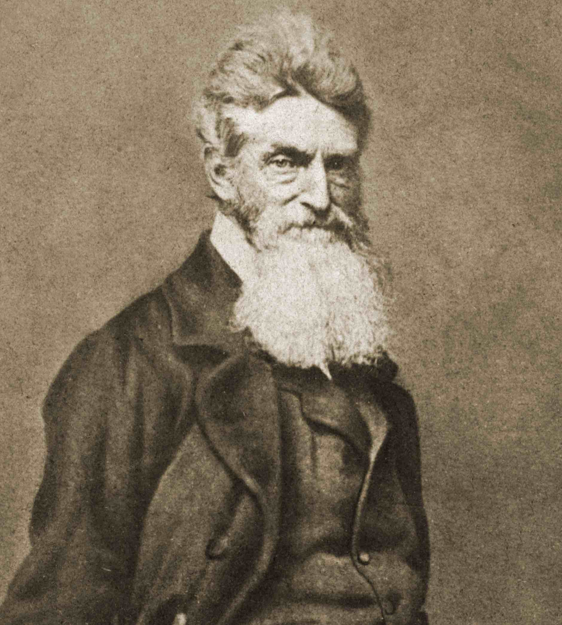 John Brown, with long white beard that is squared off at the end, right around the area where his heart is.