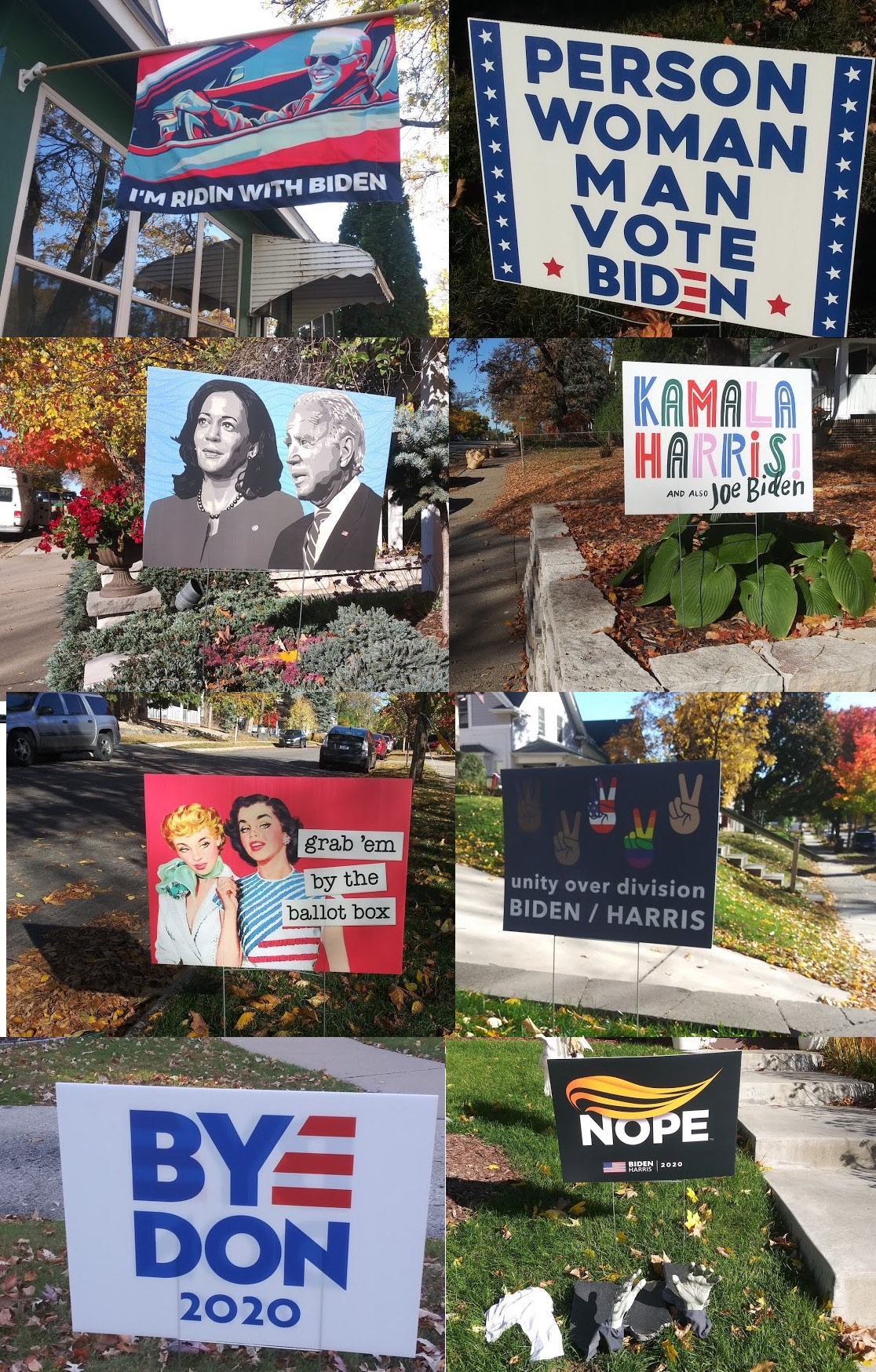 A collection of pro-Biden signs, including a hand-painted portrait of Biden/Harris, one that says 'I'm ridin' with Biden,' and one that says 'grab 'em by the  ballot box'