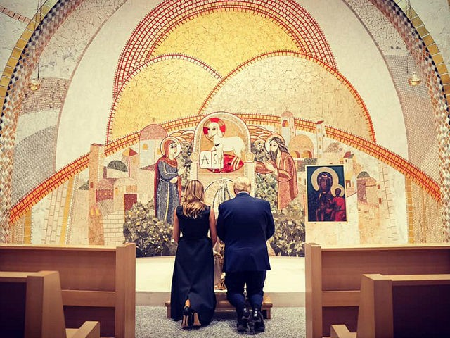The Trumps kneel at the shrine,  although just barely, which is otherwise empty but for them
