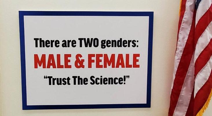 The sign says 'There are two genders, male and female, trust the science'
