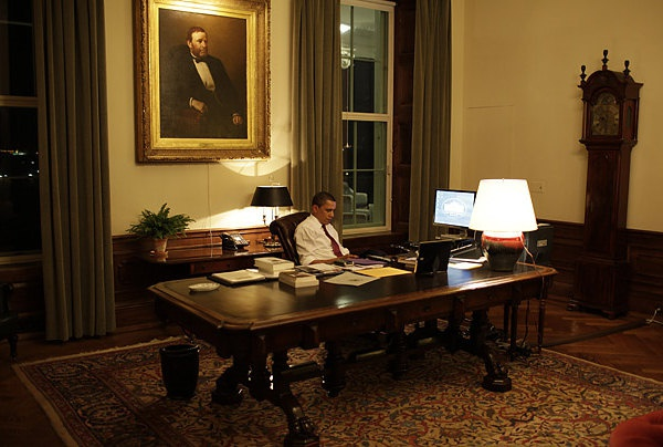 The room is quite large, the desk is huge, and there is a picture of U.S. Grant hanging above the chair where Obama is sitting