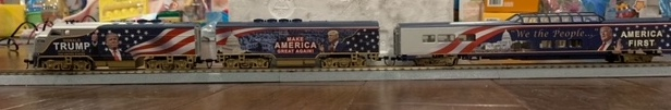 A model train adorned with Trump pictures and slogans
